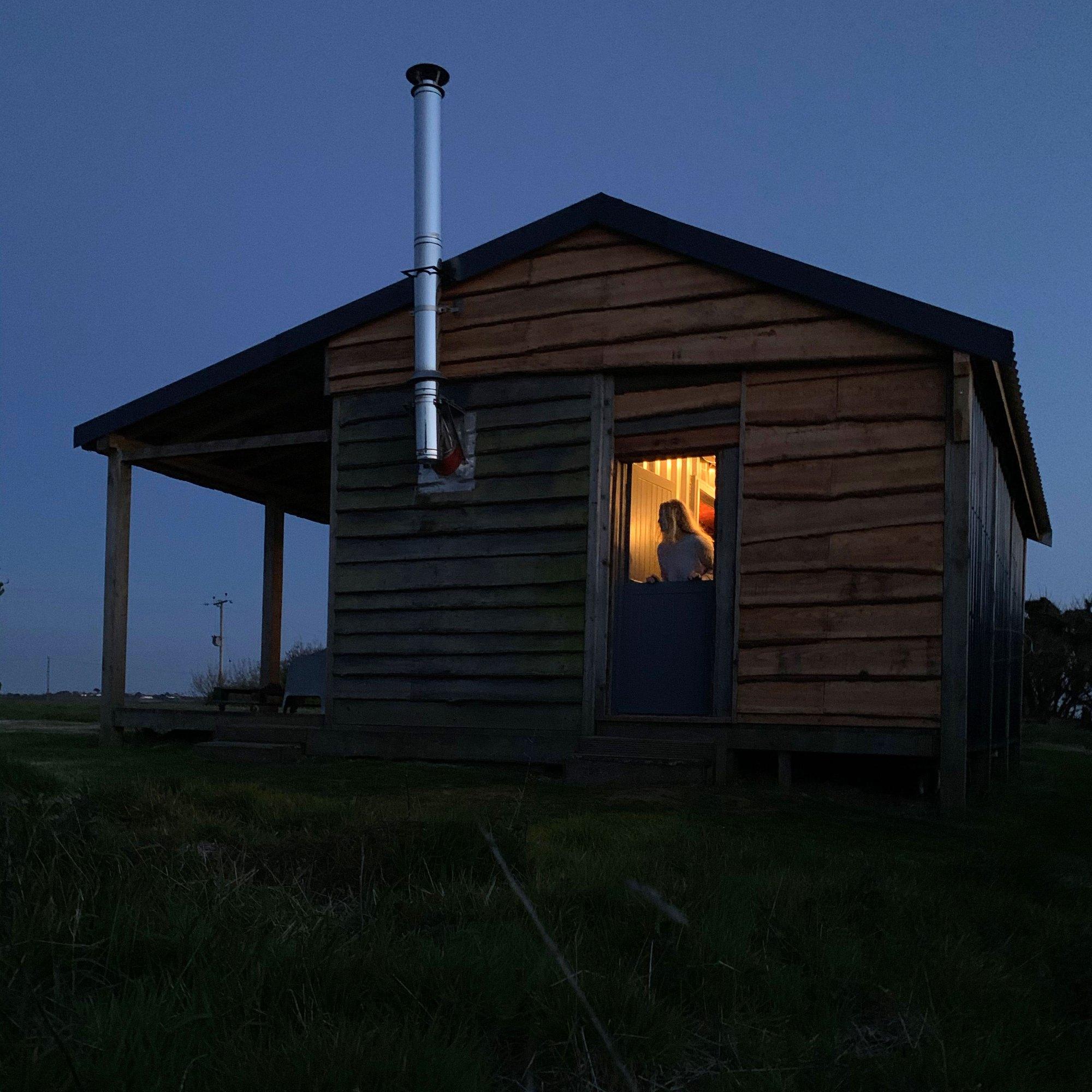 surf cabin at night