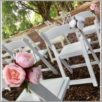 Pink and white peony posies for wedding aisle decor.