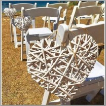 Large white wicker love hearts for chair aisle decor. Both large & small hearts.