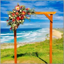 Timber wedding arch styled with fresh flowers from Ginger Lily Rose Florist. Point Cartwright, Sunshine Coast.