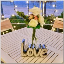 Wedding ceremony signing table styled with vase of faux flowers & love sign. Mykies By The Bay. Kawana Island, Sunshine Coast.