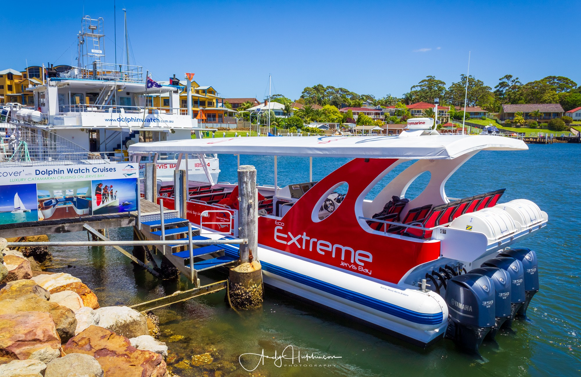 Dolphin Watch Cruises Eco Extreme cruise boat at the public wharf in Huskisson