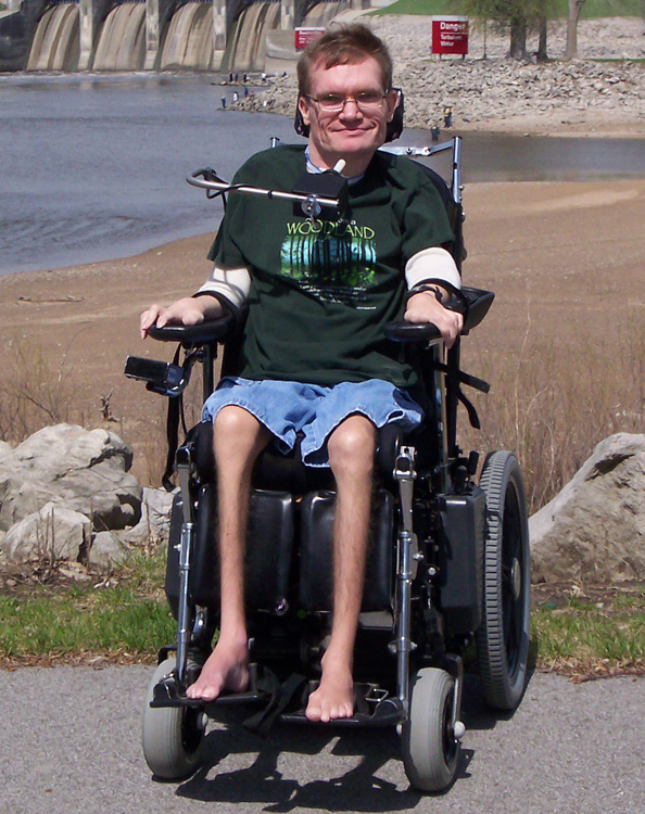 Barefoot man in wheelchair
