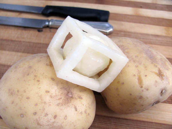 Boom! Yeah, I did that - it's a  ball carved inside a cube, carved out of a potato.