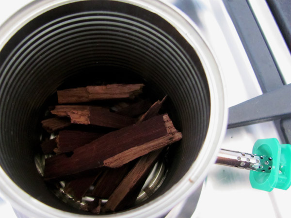 Make a whole in the bottom of a can, place solder iron in with wood chips. Presto - Smoker done!