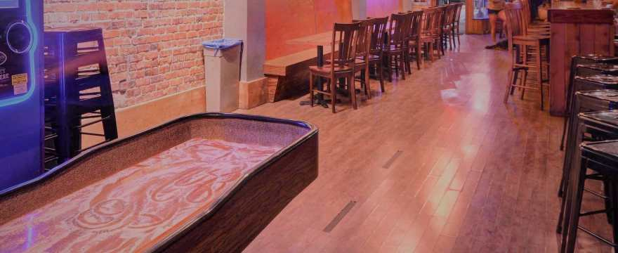 11 Awesome Bars with Shuffleboard Tables