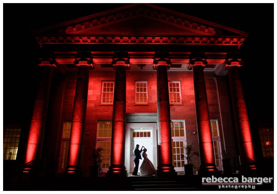 Stephanie and Michael share a private dance between the columns in the gorgeous Ellis Preserve.