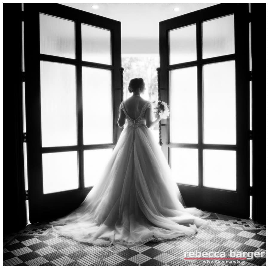 Lovely image of Becca in her Allure gown on her way to a first look with her groom at Hotel du Village, New Hope, PA.