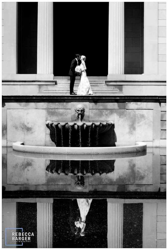 Appearing as part of the architecture, Lauren and James share a kiss at The Rodin Museum, Rebecca Barger Photography.