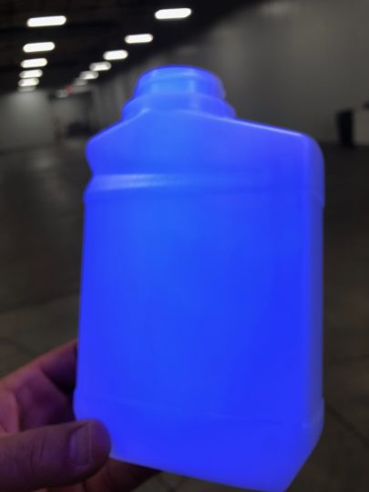 Blacklight illuminates the presence of Kortrax® in the bottle.