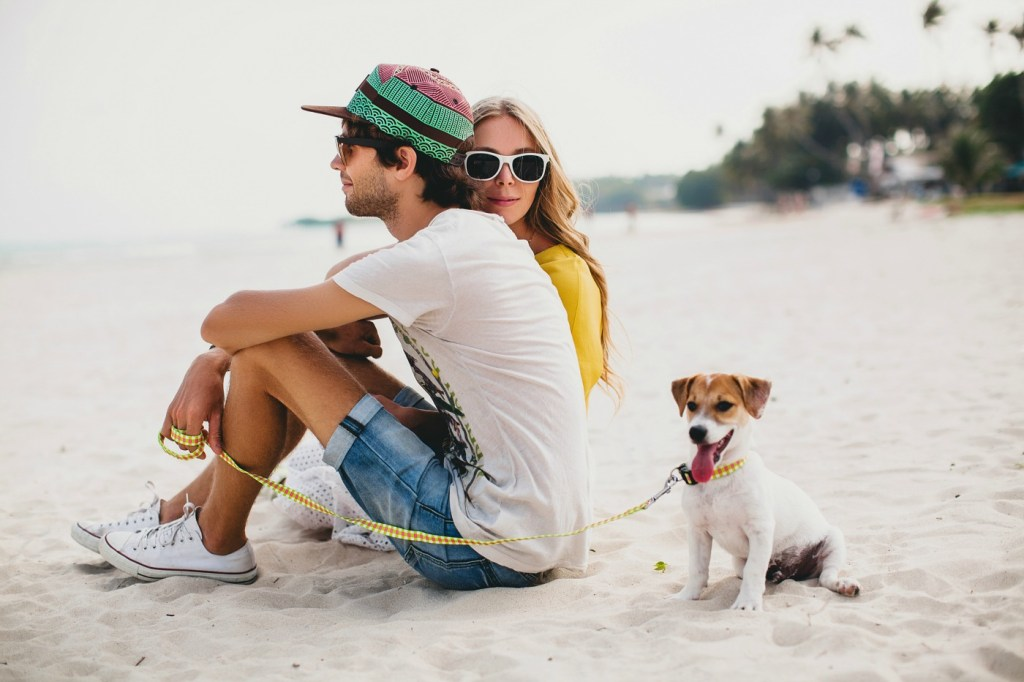 Couple at the beach with cute dog