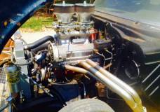 Drivers side view of Tunnel ram small block '57 Chevy
