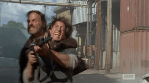 After watching the wave of shooters cross his threshold, Rick jumps out and nabs the last shooter around the neck...
