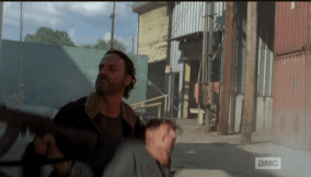 ...and grabs the shooter's gun...mmm hmmm, that's right, Rick Grimes.