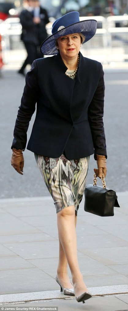 3E3AB1A200000578-4309562-Prime_Minister_Theresa_May_was_her_usual_stylish_self_wearing_sn-m-159_1489424999744
