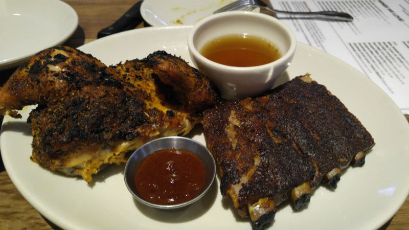 Chicken and their St. Louis ribs. Dry rub on both - Wood Ranch BBQ & Grill - BaronsBBQBeat