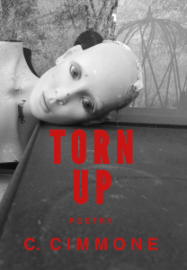 The front cover of 'Torn Up' a poetry collection by C. Cimmone. An eerie black and white image of a mannequin laying down, staring into space.