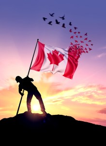 A Canadian flag turns into a flock of birds while being planted by a man on a hill during sunrise.