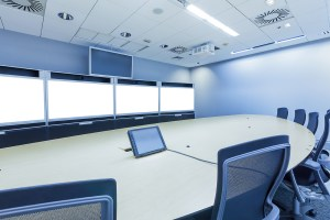 A large video conference and telepresence meeting room.