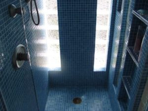 Blue mosaic shower remodeling project