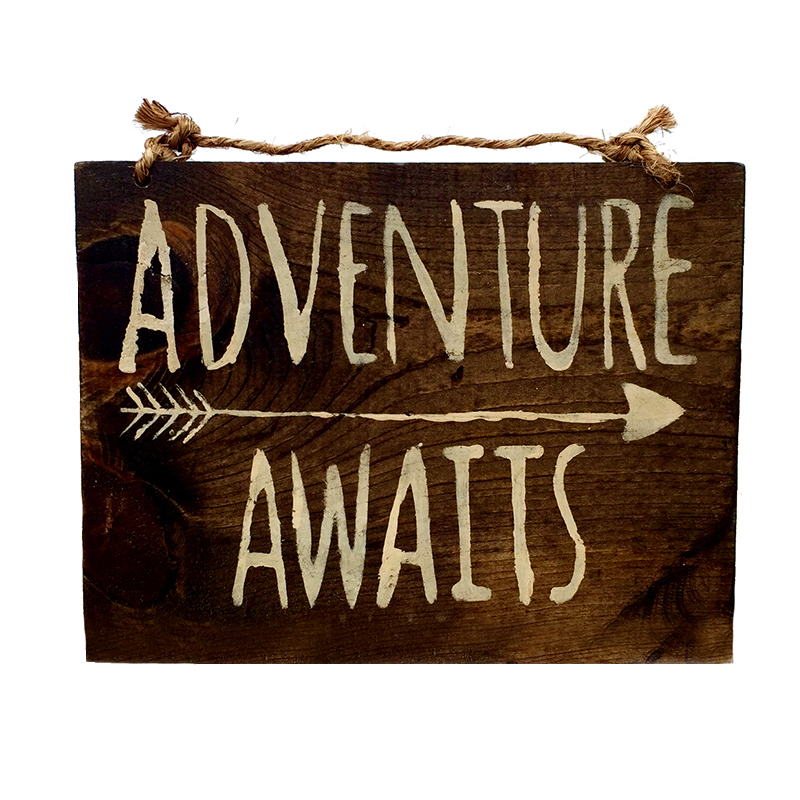 adventure awaits sign from HollyWood & Twine
