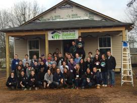 Students help with construction of a new home