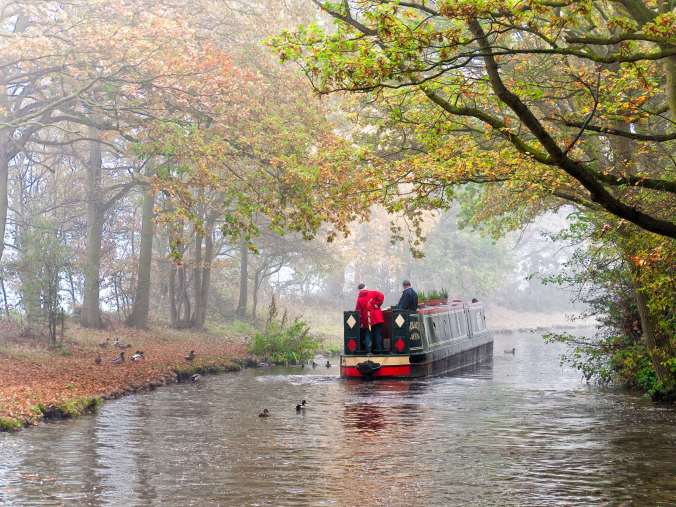 Hardy boaters probably heading towards their winter mooring