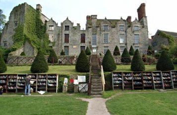 Hay on Wye, the world-famous home of books is 60 miles NE of Cardiff