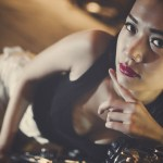 sexy thai bar girl in black tank top on motorcycle