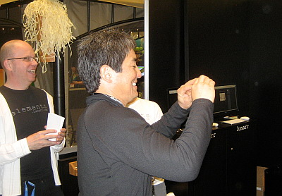 A picture of Guy Kawasaki taking a picture of the Lunarr booth.