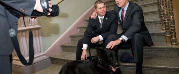 "Vice President Joe Biden meets with SEAL dog ""Chopper"" and his handler, Trevor Maroshek, a Navy SEAL Veteran."