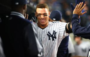Apr 17, 2017; Bronx, NY, USA; New York Yankees right fielder Aaron Judge (right) is congratulated after hitting a two run home run against the Chicago White Sox during the fifth inning at Yankee Stadium. Mandatory Credit: Andy Marlin-USA TODAY Sports