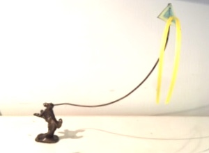 dog with kite bronze sculpture small image