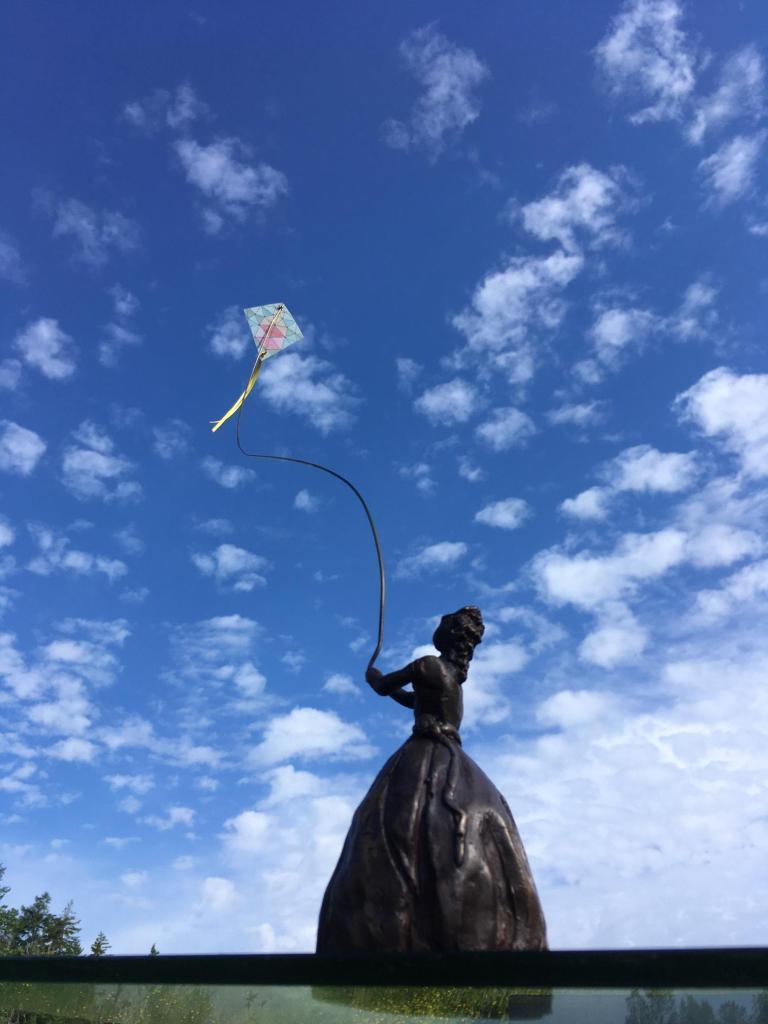 Lady Kiting bronze sculpture