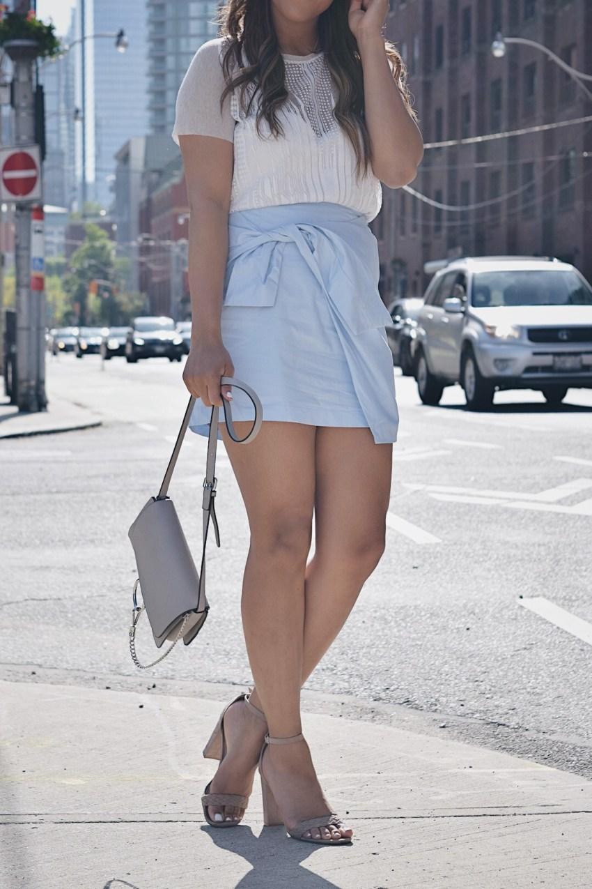 Fashion Blogger Lauren Sheriff Wearing A Baby Blue Skirt From Go Jane