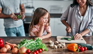 Family Cooking Healthy Food in Kitchen