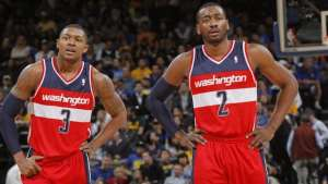 OAKLAND, CA - JANUARY 28: Bradley Beal #3 chats with teammate John Wall #2 of the Washington Wizards while facing the Golden State Warriors on January 28, 2014 at Oracle Arena in Oakland, California. NOTE TO USER: User expressly acknowledges and agrees that, by downloading and or using this photograph, user is consenting to the terms and conditions of Getty Images License Agreement. Mandatory Copyright Notice: Copyright 2014 NBAE (Photo by Rocky Widner/NBAE via Getty Images)