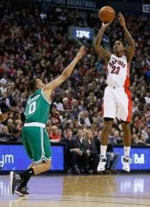 Jan 10, 2015; Toronto, Ontario, CAN; Toronto Raptors guard Louis Williams (23) shoots as Boston Celtics guard Avery Bradley (0) defends at the Air Canada Centre. Toronto defeated Boston 109-96. Mandatory Credit: John E. Sokolowski-USA TODAY Sports