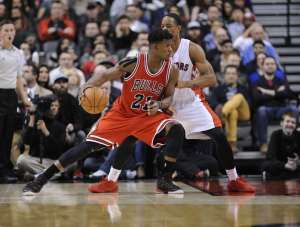 Nov 13, 2014; Toronto, Ontario, CAN;  Chicago Bulls guard Jimmy Butler (21) makes a move past Toronto Raptors guard DeMar DeRozan (10) during the fourth quarter at Air Canada Centre. Chicago won 100 - 93. Mandatory Credit: Peter Llewellyn-USA TODAY Sports