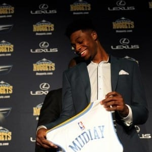 DENVER, CO - JUNE 26: Emmanual Mudiay smiles as he holds his new Nuggets jersey after a press conference on Friday, June 26, 2015 at the Pepsi Center. The Denver Nuggets held an introductory press conference at the Pepsi Center to welcome 19-year-old Emmanuel Mudiay, the 7th overall NBA draft pick, to the team on Friday, June 26, 2015. (Photo by Callaghan O'Hare/The Denver Post)