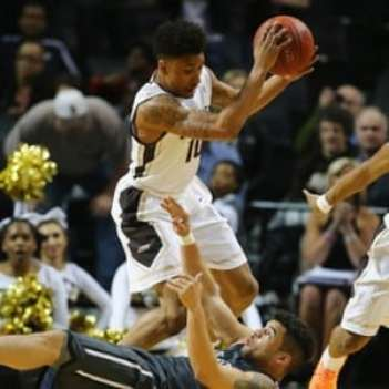 NEW YORK, NY - MARCH 11: Jaylen Adams #10 of the St. Bonaventure Bonnies grabs the ball against Jack Gibbs #12 of the Davidson Wildcats during the Quarterfinals of the Atlantic 10 Basketball Tournament at the Barclays Center on March 11, 2016 in New York, New York. (Photo by Al Bello/Getty Images)
