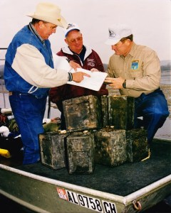 Caption 2: Ray Scott and others with batteries taken from Guntersville Reservoir in Alabama. Photo courtesy of Matt Vincent.