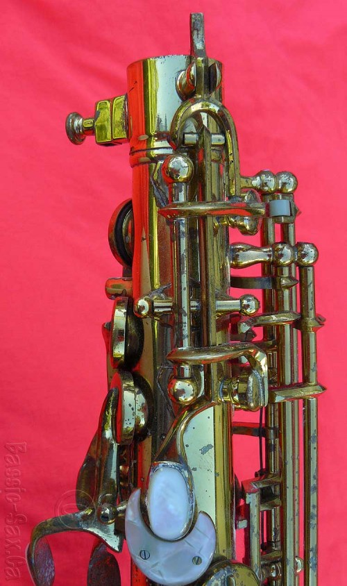 saxophone, octave key mechanism, mother of pearl, gold lacquer sax, red cloth background