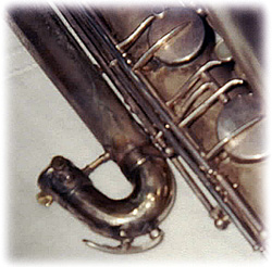 bass saxophone, water key, socket, repaired bow