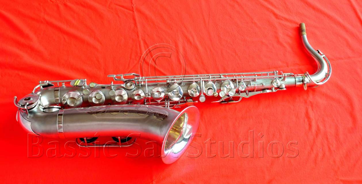 Olds Super, tenor saxophone, silver sax, vintage sax, red background