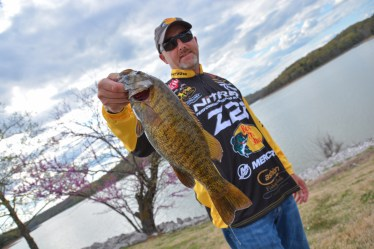 BPS veteran Tracy Adams shows off a bright Day 1 smallie. Photo by Joel Shangle.