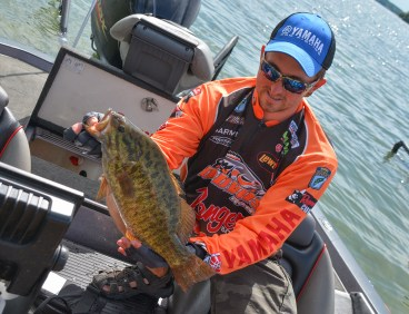 Garmin pro Paul Mueller shows off a giant Day 1 smallie. Photo by Joel Shangle.