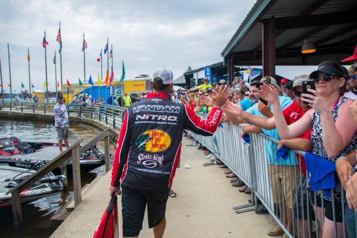 The victor's march: Kevin VanDam carries his winning bag to the stage on Champ Sunday. Photo by Joel Shangle.