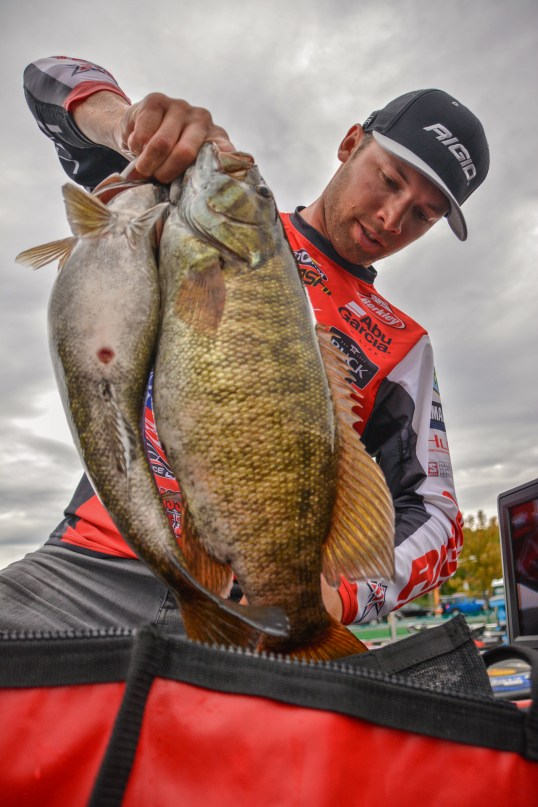 Rigid Industries pro Brandon Palaniuk tries to stuff 22 pounds of smallmouth into a 20-pound bag. Photo by Joel Shangle.