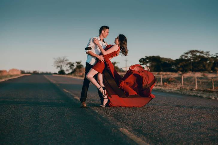 photo of man and woman on road